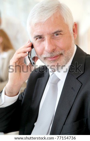 Portrait of senior businessman talking on the phone - stock photo