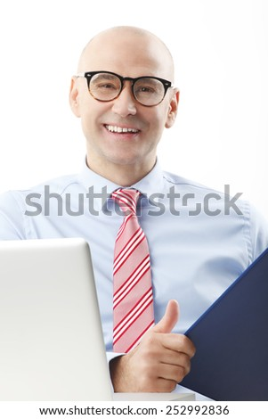 Portrait of senior chief financier officer sitting in front of computer and analyzing data. Business people.  - stock photo