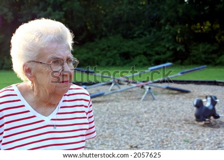 Portrait of senior citizen woman at a playground.