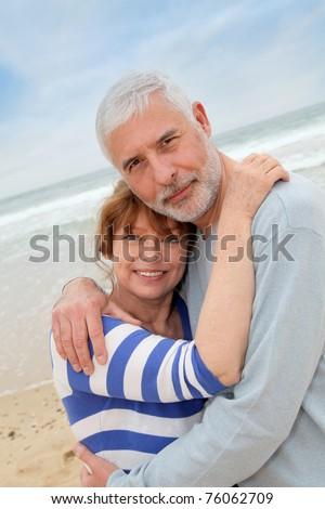 Portrait of senior couple at the beach - stock photo
