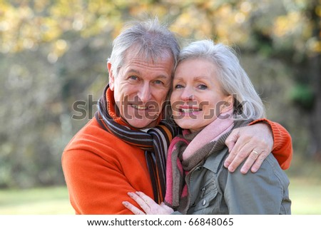 Portrait of senior couple in countryside - stock photo