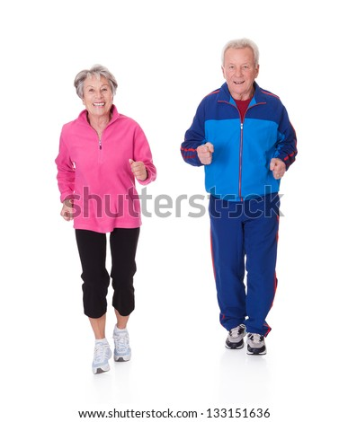 Portrait Of Senior Couple Jogging Over White Background - stock photo