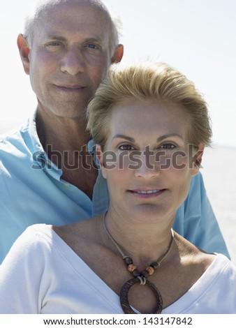 Portrait of senior couple on tropical beach - stock photo