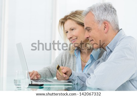 Portrait Of Senior Couple Shopping Online With Credit Card - stock photo