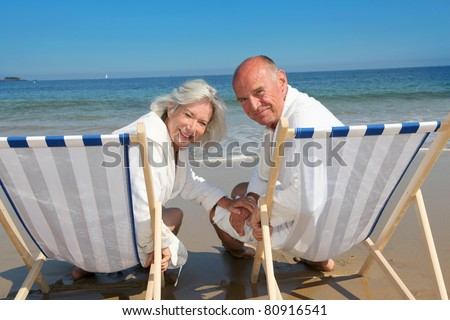 Portrait of senior couple sitting in deckchairs