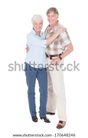 Portrait Of Senior Couple Smiling Over White Background - stock photo