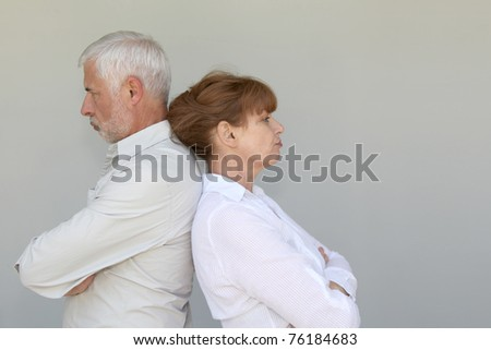 Portrait of senior couple upset at each other - stock photo