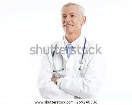 Portrait of senior doctor with arms crossed standing against white background. Isolated on white background.  - stock photo