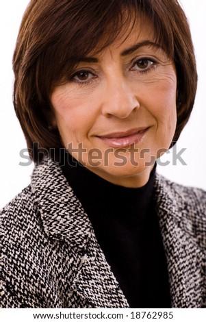 Portrait of senior executive businesswoman, white background. - stock photo