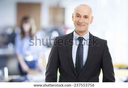 Portrait of senior executive director standing at office. - stock photo
