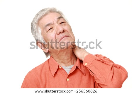 portrait of senior Japanese man suffers from neck ache - stock photo