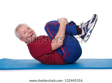 Portrait Of Senior Man Exercising On White Background - stock photo