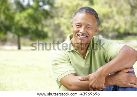 Portrait Of Senior Man In Park - stock photo
