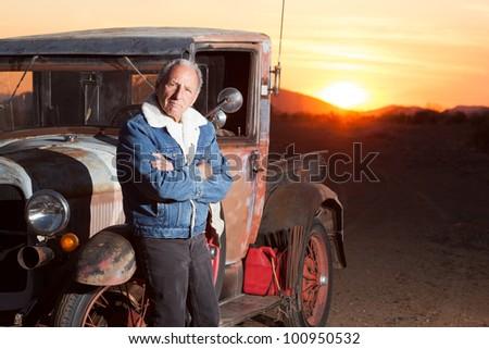 Portrait of Senior Man Next to His Vintage Truck - stock photo