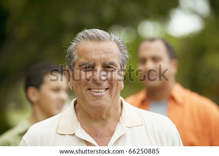 Portrait of senior man smiling - stock photo