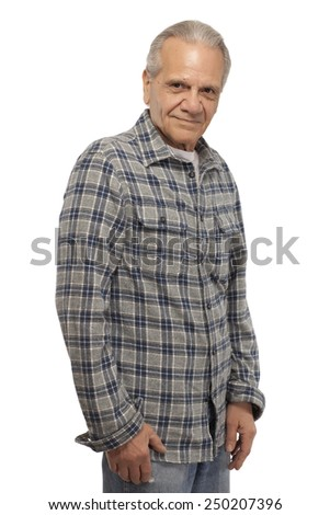 Portrait of senior man standing against isolated white background