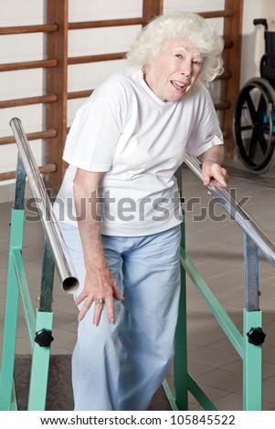 Portrait of senior woman having ambulatory therapy. - stock photo