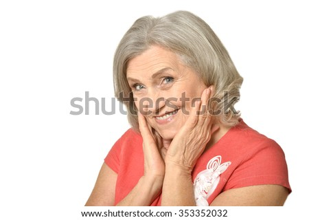 Portrait of senior woman in bright dress on white background - stock photo