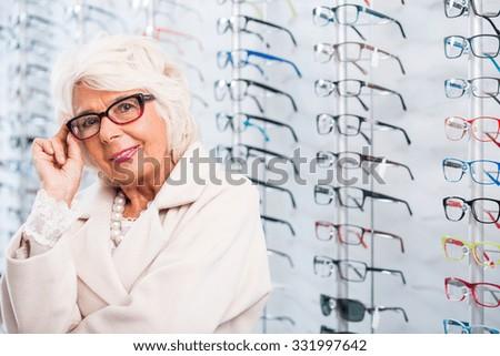 Portrait of senior woman in stylish eyeglasses - stock photo