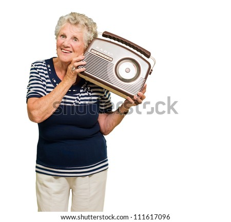 Portrait Of Senior Woman Listening Music From Radio Isolated Over White Background - stock photo