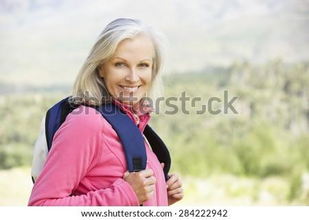 Portrait Of Senior Woman On Hike - stock photo