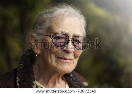 Portrait of senior woman outdoors. Closeup. - stock photo