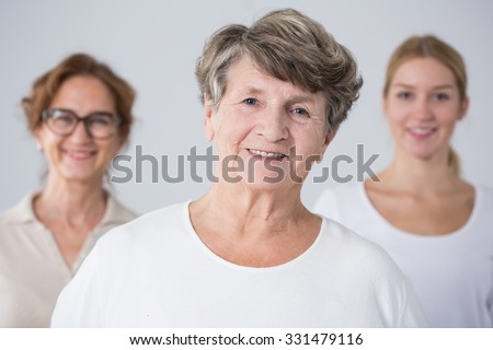 Portrait of senior woman with her family - stock photo