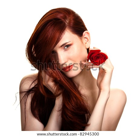 Portrait of sensual beautiful woman with red rose on white background - stock photo