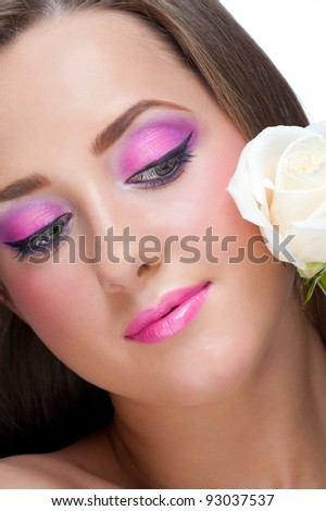 Portrait of sensual beautiful woman with white rose and stylish bright make-up