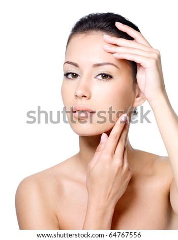 Portrait of sensual beautiful young woman stroking her face - white background - stock photo