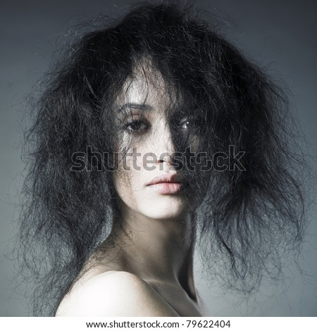 Portrait of sensual lady with magnificent bushy hair - stock photo