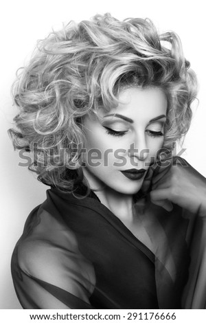 Portrait of sensual mature thoughtful woman. Black and white photo. - stock photo