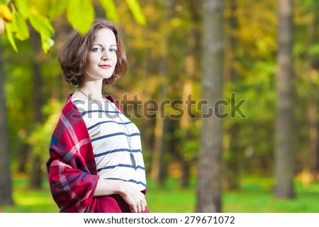 Portrait of Sensual Smiling Caucasian Brunette Female in The Forest. Horizontal Image Composition - stock photo