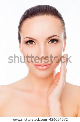 Portrait of sensual woman applying cream on her face