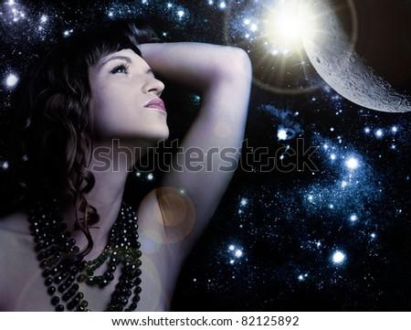 portrait of sensual woman over universe - stock photo