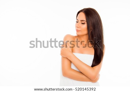 Portrait of sensual young brunette in towel isolated on white background