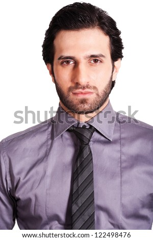 portrait of serious and confident businessman, close up of a serious young businessman - stock photo