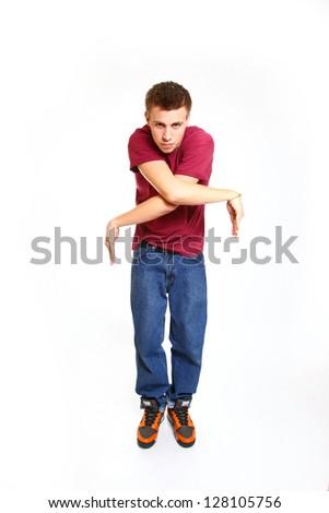 Portrait of serious boy dancing breakdance - stock photo
