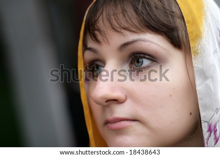 Portrait of serious brunette girl in kerchief - stock photo
