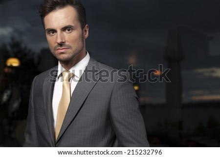 Portrait of serious businessman in office - stock photo