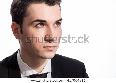 Portrait of serious caucasian businessperson looking away from the camera, dressed in suit and isolated on white background - stock photo