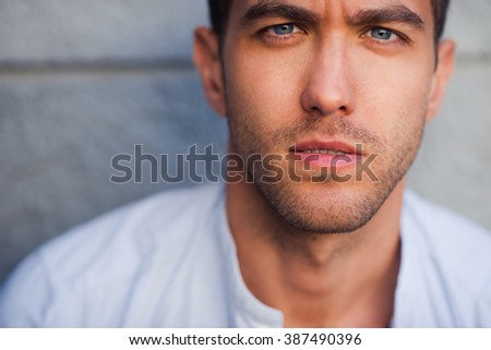 Portrait of serious handsome man looking at the camera  - stock photo