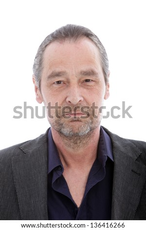 Portrait of serious middle aged man on white background - stock photo