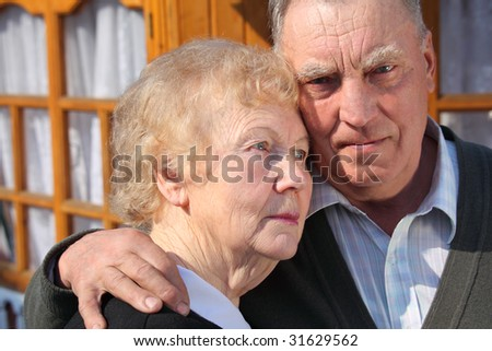 Portrait of serious thinking elderly couple closeup - stock photo