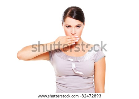 portrait of serious woman covering her mouth over white background - stock photo