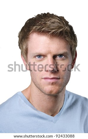 portrait of serious young man isolated against white - stock photo