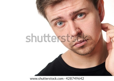 Portrait of serious young man, questioning expression,horizontal  on white background with space for text