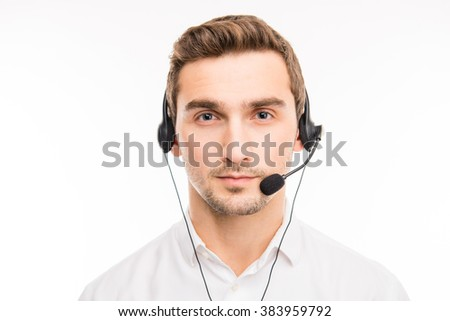 Portrait of serious young manager of call-center with headphones - stock photo
