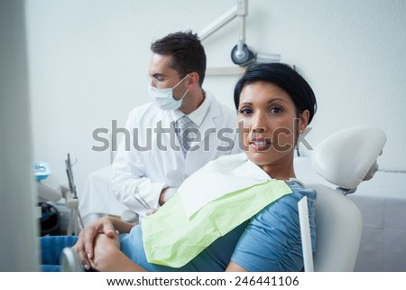 Portrait of serious young woman waiting for a dental exam - stock photo