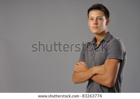 Portrait of seriously looking teenager - stock photo